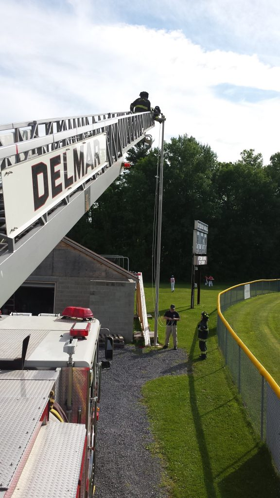 Line Drive's Flag Pole Receives Assistance From Delmar FD Truck 20 & Crew Hoisting Halyard